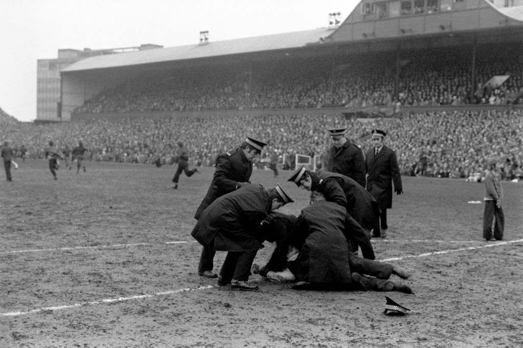 Soccer - FA Cup - Sixth Round - Newcastle United v Nottingham Forest Policemen apprehend one of the hundreds of Newcastle United fans who invaded the pitch when their team went 3-1 down in a bid to get the match abandoned and replayed Ref #: PA.723464  Date: 09/03/1974