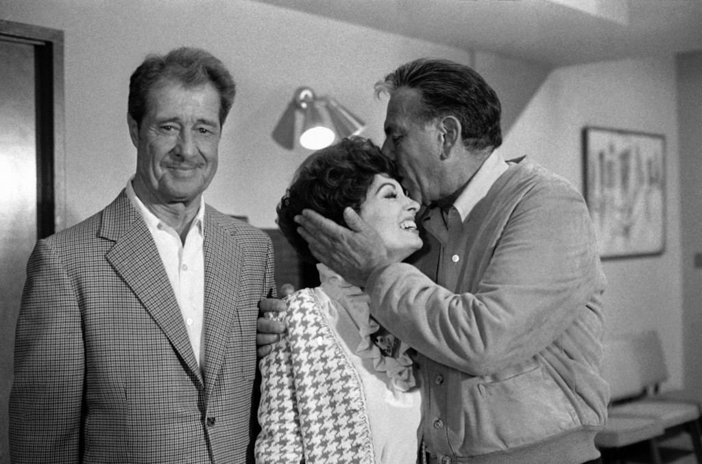 Don Ameche, left, and Ann Blyth, center, as guest stars, join Jack Klugman on the set for an episode of the television series, Quincy, June 22, 1978, Los Angeles, Calif. Klugman plays the title role, a medical examiner, in Quincy, after five years in The Odd Couple. Klugman was anxious for the series not to turn into just another detective show. What I like about Quincy is that you dont see forensic medicine anywhere else on television, he says. Youre not just another cop. (AP Photo/Nick Ut) Ref #: PA.7259441  Date: 22/06/1978