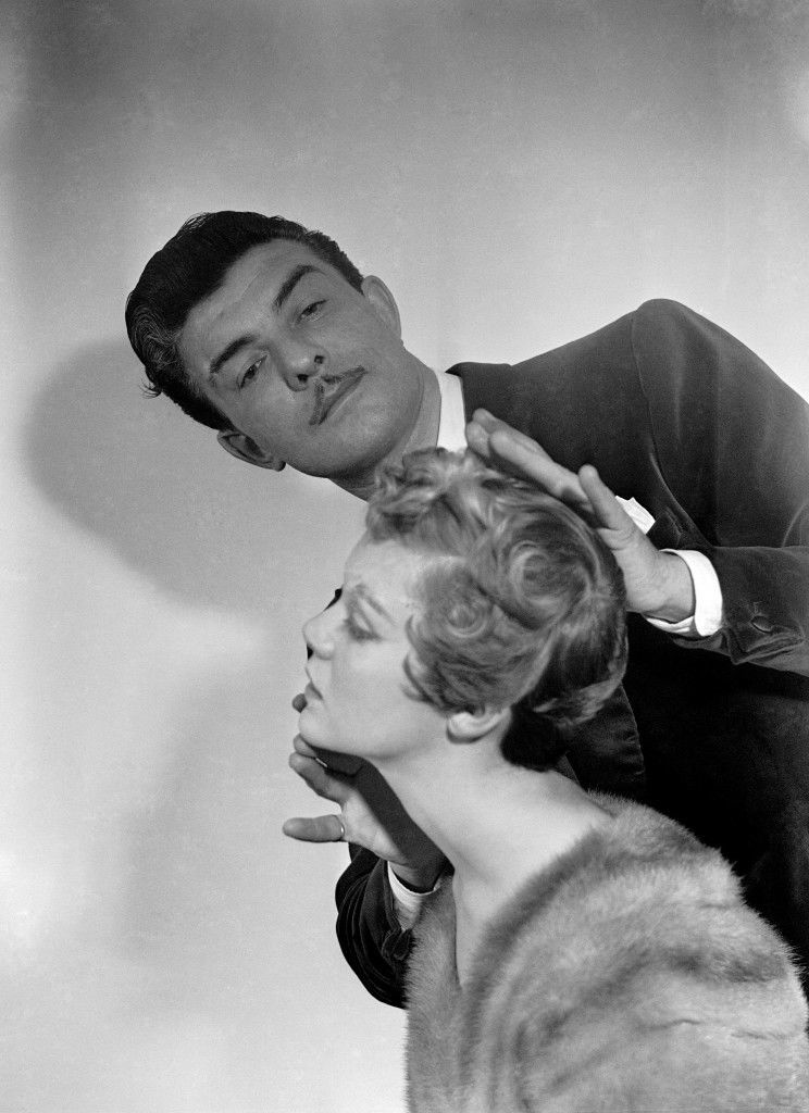 Celebrity hairdresser Raymond Bessone, also known as 'Mr Teasy-Weasy' at work on singer Jackie Cahill's hair. Ref #: PA.7413471  Date: 07/01/1954
