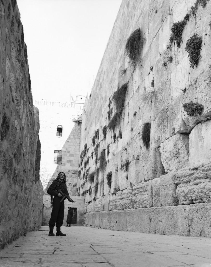An Arab, armed with a sub-machine gun, stands guard at Jerusalem's Wailing Wall on Feb. 23, 1948. Jews are being kept from this centuries-old holy place by Arabs for the first time since the Arab-Jewish disorders in 1939. (AP Photo/JP) Ref #: PA.7436344 Date: 23/02/1948