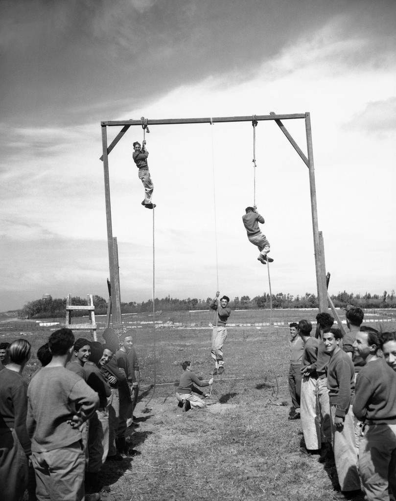 With registration on full swing, Haganah, the Jewish defense organization, puts all recruits through stiff training courses on March 11, 1948 in Jerusalem. There are several such camps, set up in secret locations. Besides training in the sued of arms, the youths are pout through a strenuous body conditioning program. At one stage of training, the recruits climb hand-over-hand up hanging ropes. (AP Photo) Ref #: PA.7445873 Date: 11/03/1948