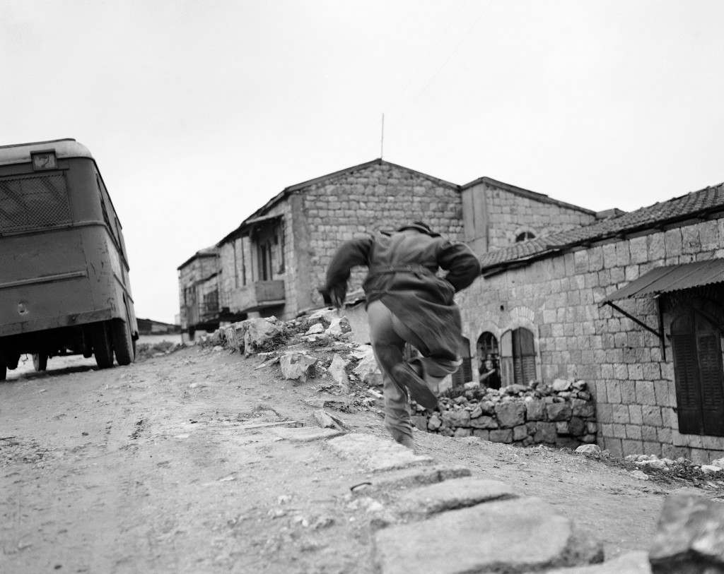 Caught in the open during Arab-Jewish skirmish in Montefiore, a Jewish quarter in Jerusalem, Palestine, a Jew dashes for cover as an Arab sniper fires on him, Feb. 10, 1948. Two British companies were called out to halt the battle which started when Arabs attempted to smash into Jewish quarter of the city. (AP Photo/Jim Pringle) Ref #: PA.7450598 Date: 10/02/1948