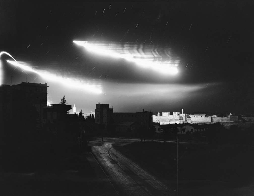 The glare from fires set by mortar and artillery shells and the flares set up by opposing fighters in the fierce battle between Arabs and Jews light up the sky above the David's Tower section of the Old City Wall of Jerusalem, held by the Arabs, July 14, 1948. It was one of the heaviest exchanges of fire in the long struggle for the Holy City. (AP Photo/Jim Pringle) Ref #: PA.7450612 Date: 14/07/1948