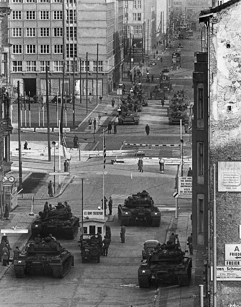 U.S. Army tanks, foreground, at Checkpoint Charlie, and Soviet Army tanks, opposite, face each other in the most dangerous of several crises at the Friedrichstrasse checkpoint in Berlin during the Cold War, Oct. 28, 1961. The armor remained in position for more than 16 hours at one of the few crossing points in the wall that divided Communist East Berlin and West Berlin. The Russians retreated to a ruined royal palace while the Americans moved to a bombed site. (AP Photo/Kreusch) PA-7608487