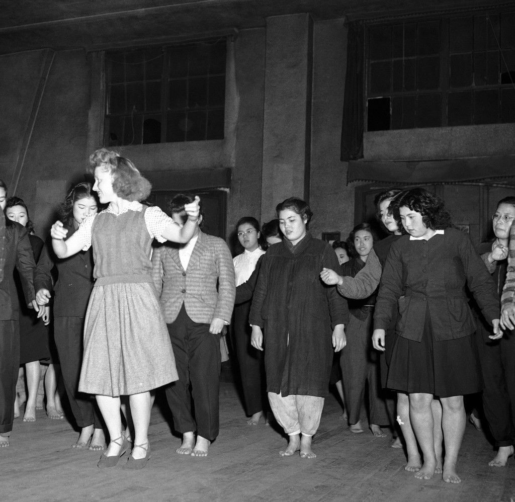 Barbara McBride teaches Russian-style Korobotchka dance to her Japanese students in Tokyo at the YWCA, once a week as seen here, Dec. 29, 1946. (AP Photo) Ref #: PA.7641875