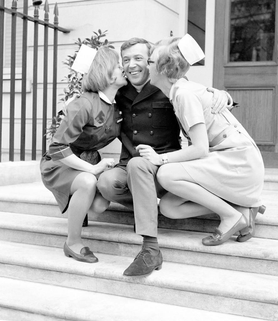 Val Doonican gets a farewell kiss from Sister Brenda Midgloy and Nurse Susan Toothill on the steps pf the Fitzroy-Nuffield Hospital, London. Ref #: PA.7900315  Date: 28/03/1970