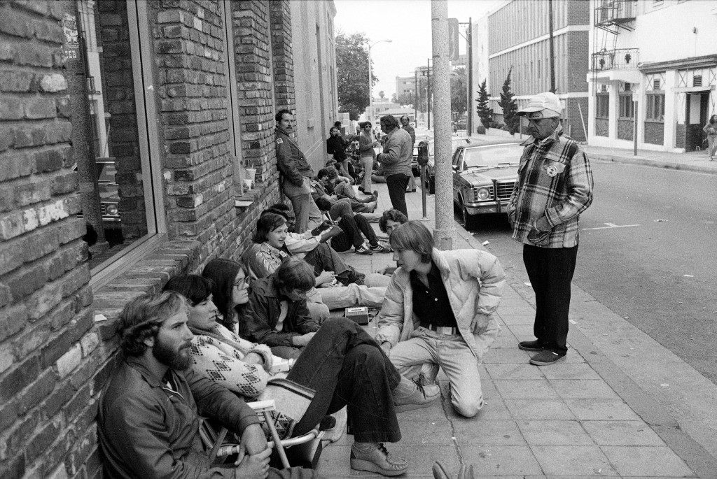"People maintain their places in line awaiting the midnight premiere of ""The Empire Strikes Back,"" the sequel to ""Star Wars,"" May 21, 1980. Some of the fans expected to be in line as long as 36 hours in order to be among the first in the nation to view the new movie. (AP Photo/Nick Ut)"