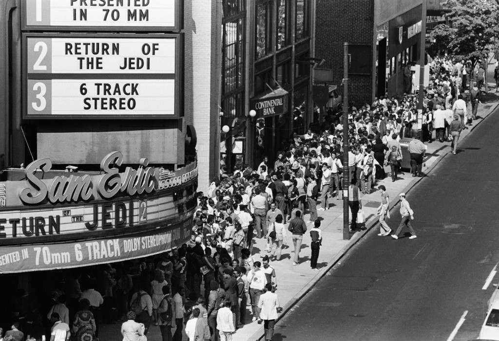 "Movie fans line up on Philadelphia's Chestnut Street for the premiere of the Movie ""Return of the Jedi"" Wednesday May 23, 1983. Fans began lining up Tuesday night to see the Star Wars trilogy. (AP Photo/ George Widman)"