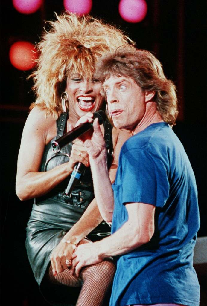 Tina Turner reacts as Mick Jagger grabs her tight during their duo at the Live Aid concert Saturday night in Philadelphia, July 13, 1995 (AP-Photo/Amy Sancetta)