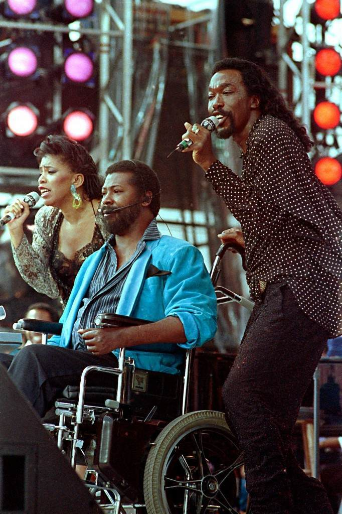 In a July 13, 1985 file photo singers from left, Valerie Simpson, Teddy Pendergrass and Nicholas Ashford perform at JFK Stadium in Philadelphia Pa. during the Live Aid famine relief concert. Pendergrass died Wednesday Jan. 13, 2010 in Philadelphia at age 59. (AP Photo/ Amy Sancetta) PA-8201563