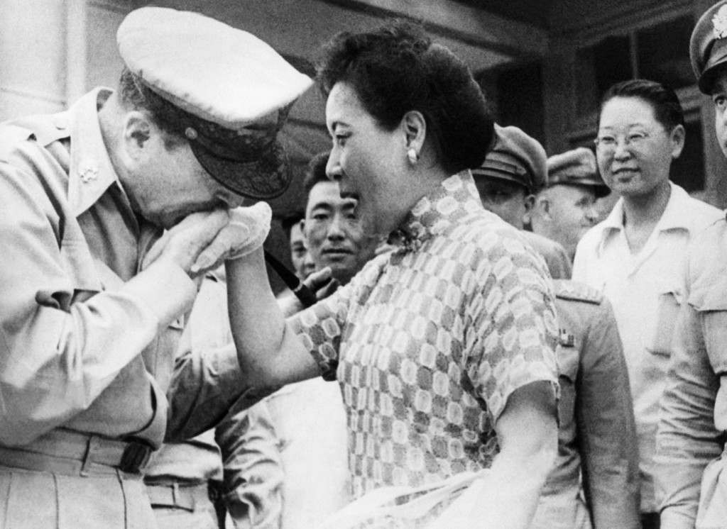 Gen. Douglas MacArthur kisses the white-gloved hand of Madame Chiang Kai-shek on August 7, 1950 just before he departed from Taipei, Formosa for Tokyo after a conference with Generalissimo Chiang Kai-shek and Nationalist government leaders. (AP Photo) Ref #: PA.8350369