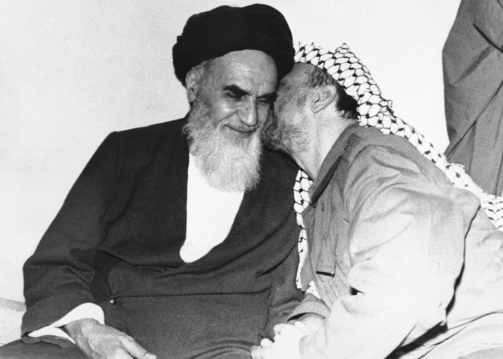 Palestine guerilla leader Yasser Arafat gives a kiss to Ayotolla Ruhollah Khomeini Saturday night, February 18, 1979, during their meeting in Tehran, Iran. (AP Photo) Ref #: PA.8485689  Date: 18/02/1979