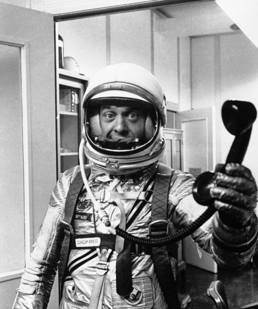 Alan Shepard, in his space suit makes last minute preparations for his historic ride into space, June 14, 1963. (AP Photo) Ref #: PA.8566500