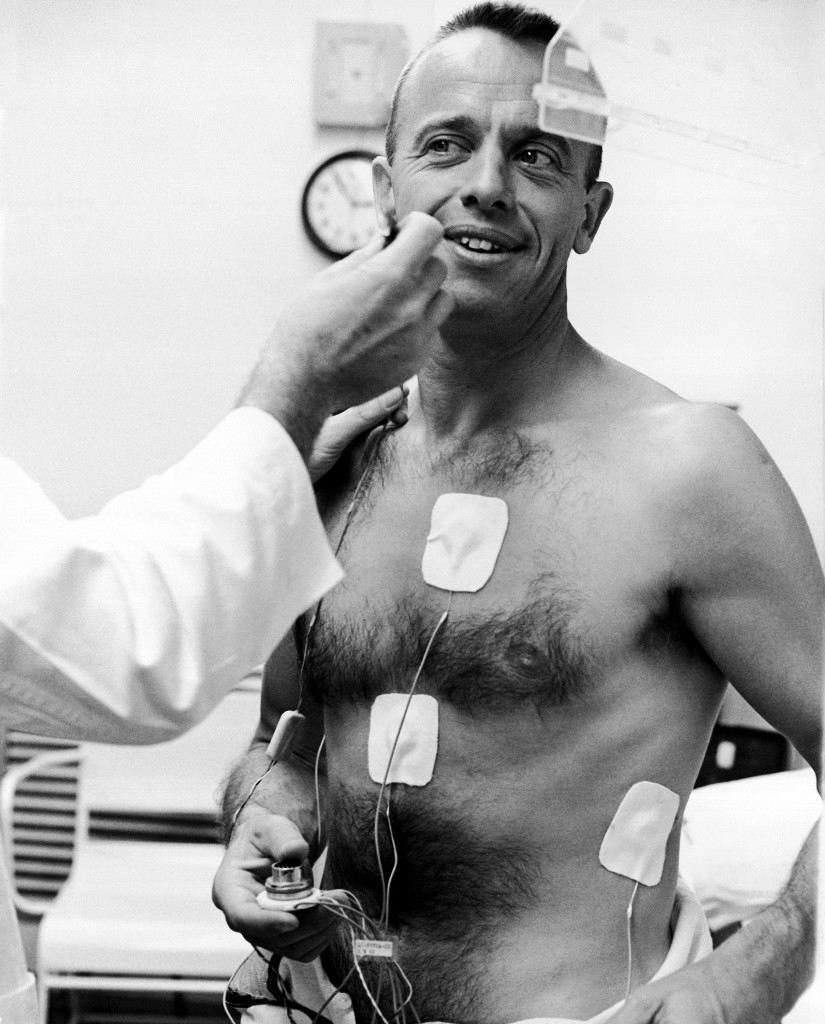 Sensors are attached to body of astronaut Alan B. Shepard, Jr., just before he was fitted into his space suit for manned space flight from Cape Canaveral, May 5, 1961. (AP Photo) Ref #: PA.8611807