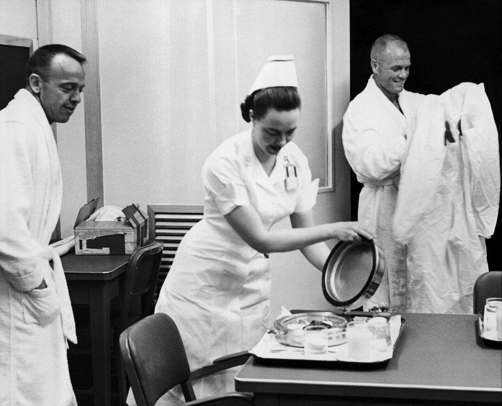 A nurse serves breakfast for Astronaut Alan B. Shepard, Jr., left in his special quarters at Cape Canaveral, May 5, 1961 before he was suited for his space flight. At right is John H. Glenn, Jr., backup pilot for the manned flight. (AP Photo) Ref #: PA.8611835
