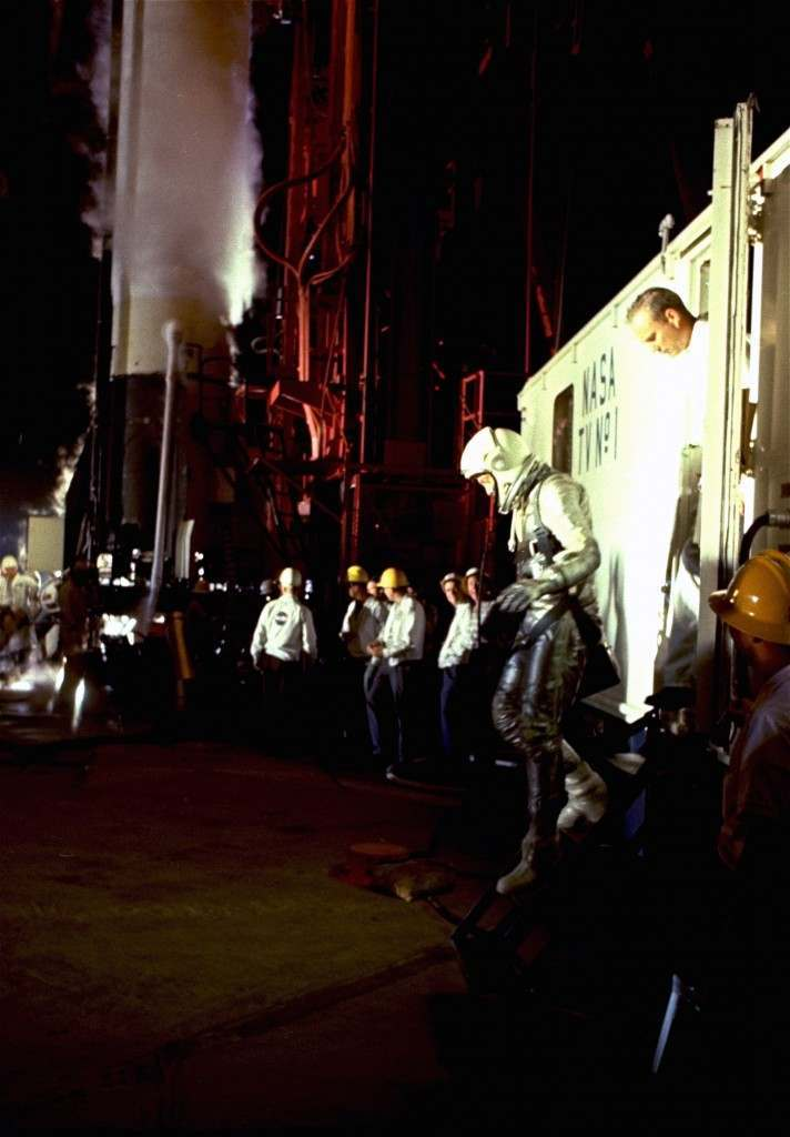 In his silver space suit, Alan B. Shepard, Jr., strides from the van as he arrives at the launching pad May 5, 1961 space flight from the cape. Towering in the background is the rocket which took Shepard on this country's first manned space flight. (AP Photo) Ref #: PA.8628364
