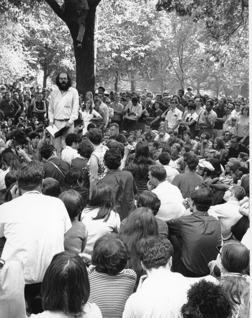 A crowd listens to Allen Ginsberg give a reading of uncensored poetry at New York City's Washington Square park on Aug. 28, 1966. The bearded poet joined others in giving the reading in order to test a New York Supreme court decision permitting poets to give uncensored readings in public parks. (AP Photo) Ref #: PA.8629486