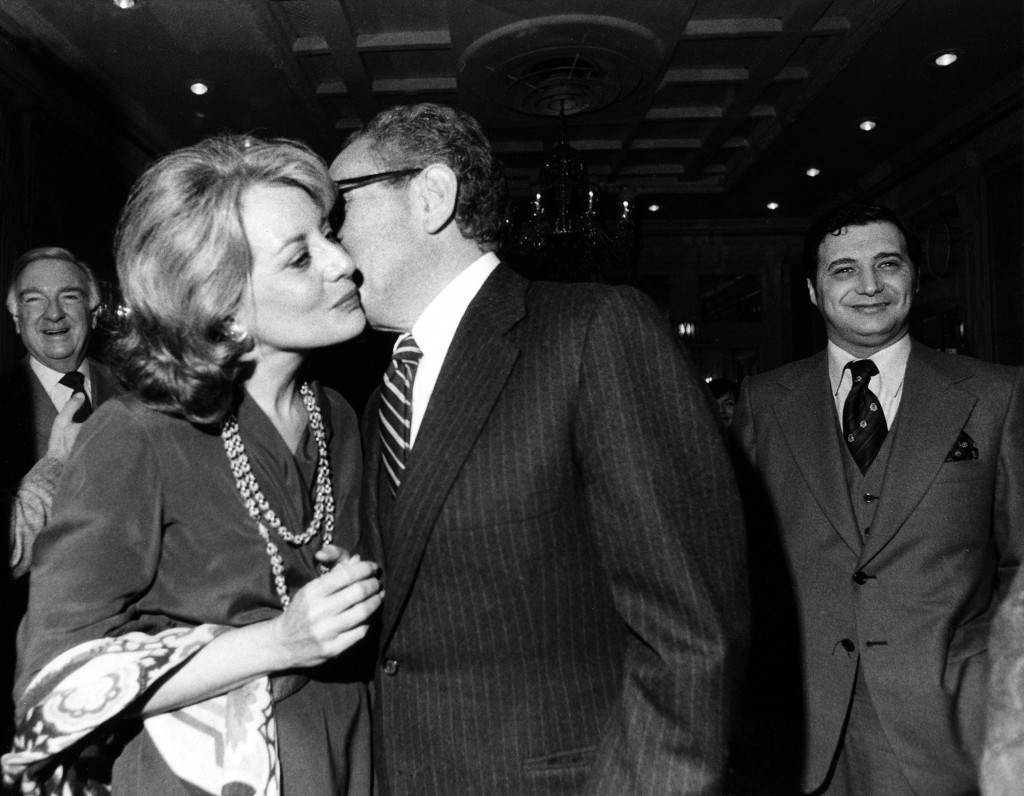 Former secretary of state Henry Kissinger gives a kiss to ABC ABC's newswoman Barbara Walters at the Plaza Hotel in New York, November 28, 1978, after Walters was honored with an awards from the Anti-Defamation League of B'nai B'rith. In the background left is CBS anchorman Walter Cronkite, who was also honored. (AP Photo/Suzanne Vlamis) Ref #: PA.8631261  Date: 28/11/1978