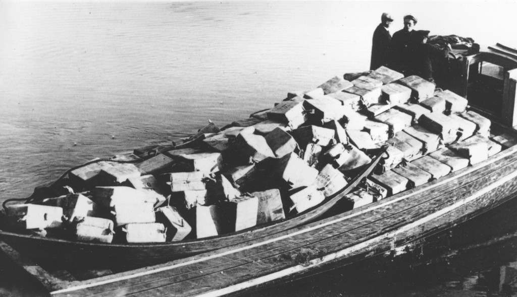 Coast guardsmen stand on a speed boat packed with nearly 700 cases of liquor they captured as it was unloaded at Newburyport, Mass., on the morning of May 6, 1932. They pursued the craft from outside the harbor into the Merrimack River. The crew fled as the government boat approached. (AP Photo) Ref #: PA.8631861  Date: 06/05/1932