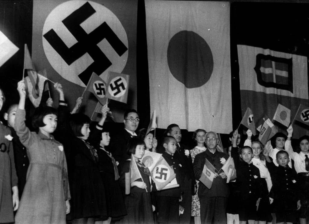 Children of Japan, Germany, and Italy meet in Tokyo to celebrate the signing of the Tripartite Alliance between the three nations, December 17, 1940. Japanese education minister Kunihiko Hashida, center, holding crossed flags, and Mayor Tomejiro Okubo of Tokyo were among the sponsors. (AP Photo) Ref #: PA.8632668