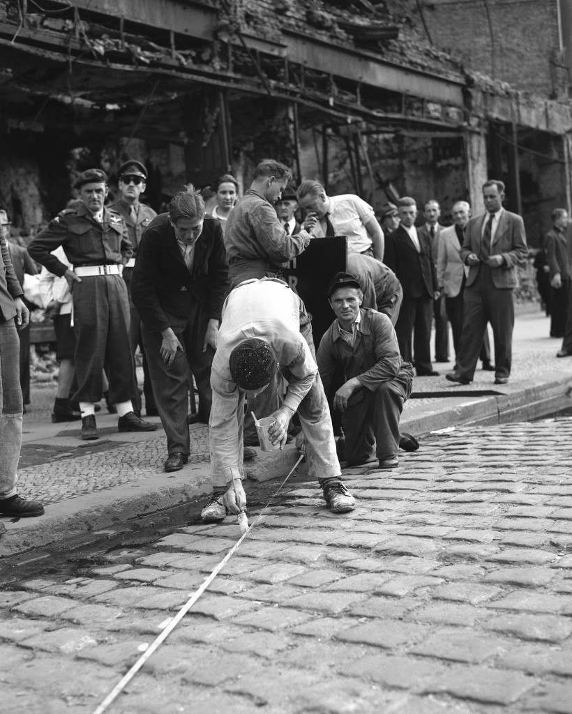 German painters mark British-Russian border line at Potsdamerplatz in Berlin, Aug. 21, 1948. British military police watch from background. (AP Photo) Ref #: PA.8635890 Date: 21/08/1948