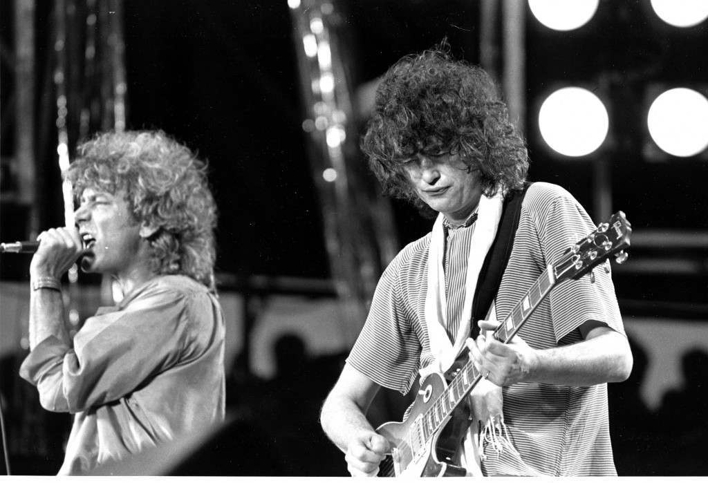Leadsinger Robert Plant, left, and guitarist Jimmy Page, right, of the British rock band Led Zeppelin perform at the Live Aid concert at Philadelphia's J.F.K. Stadium, on July 13, 1985. (AP Photo/Rusty Kennedy) PA-1880417