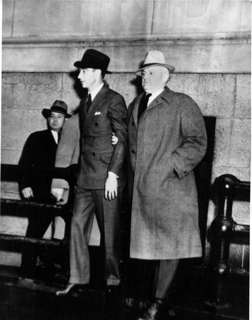 Owney Madden, left, owner of the Cotton Club during prohibition, is escorted by an unidentified detective as they leave police headquarters for questioning on May 4, 1940. (AP Photo) Ref #: PA.8640050 Date: 04/05/1940