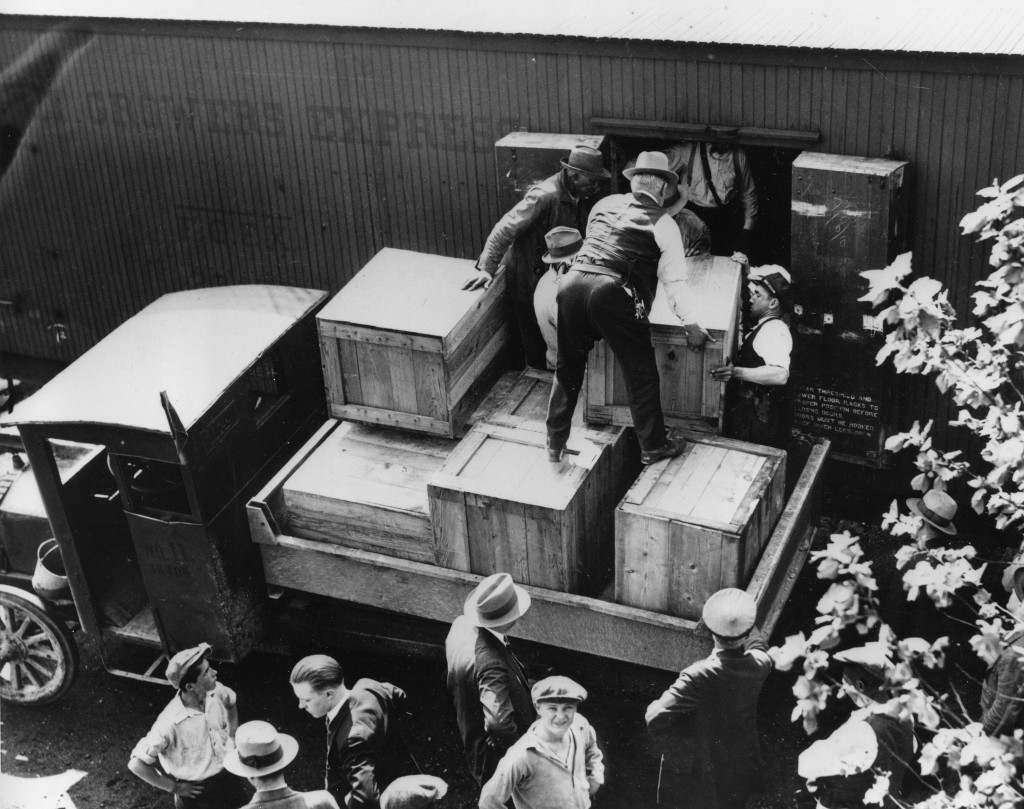 Authorities unload cases of whiskey crates labeled as green tomatoes from a refrigerator car in the Washington yards on May 15, 1929. The grower's express cargo train was en route from Holandale, Fla., to Newark, N.J. (AP Photo) Ref #: PA.8642868 Date: 15/05/1929