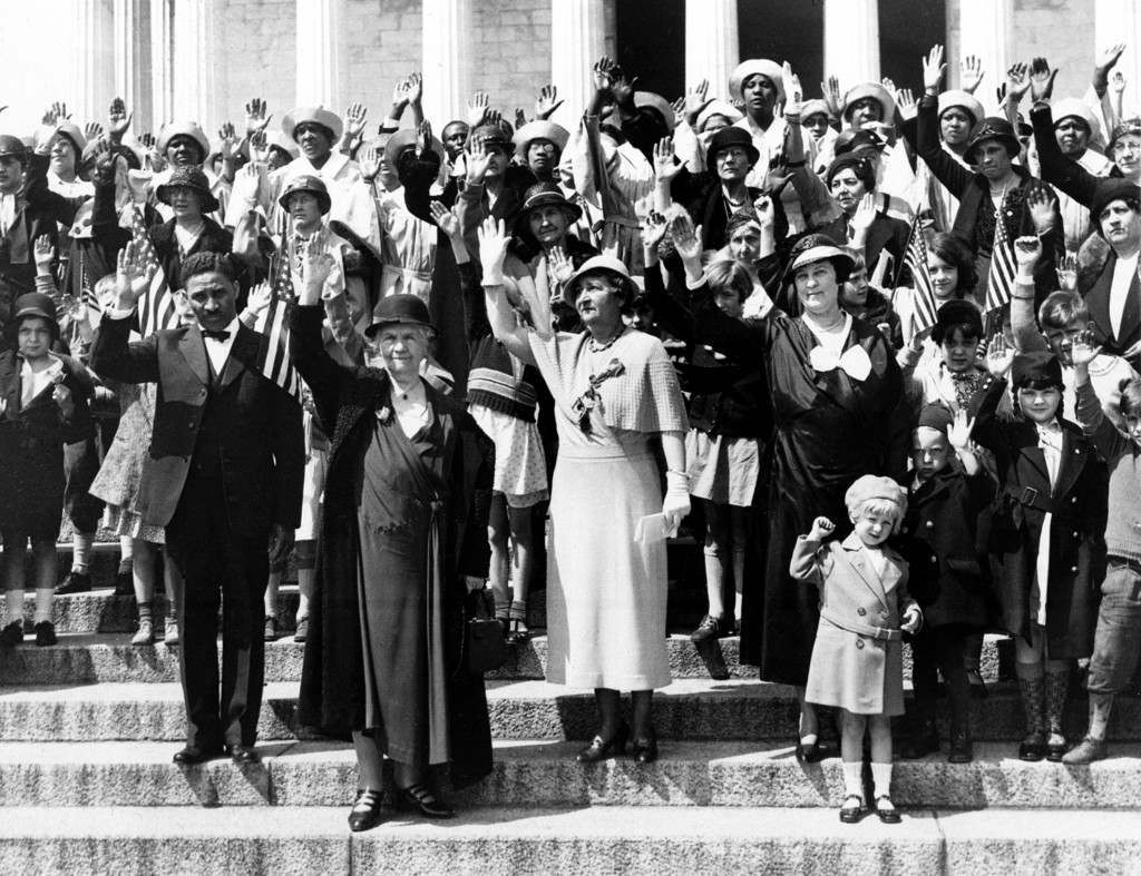 A delegation of women, joined by some men and children, pledge themselves to fight the prohibition laws as they stand in front of the Lincoln Memorial in Washington, D.C., April 14, 1933. Leading the delegation is Mrs. Henry W. Peabody, front row, left. The woman at center is Mrs. A. Haines Lippincott of Camden, N.J., and Mrs. Jesse Nicholson of Maryland is at right. (AP Photo) Ref #: PA.8643825  Date: 14/04/1933