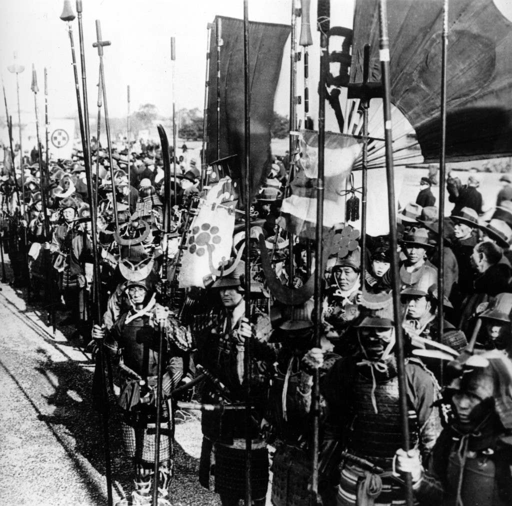 Hundred of Buddhists, clad in the armor of old time Japanese samurai, are forming a procession through Tokyo, carrying an image of Buddha from one temple to another, on January 28, 1933. (AP Photo) Ref #: PA.8644286 Date: 28/01/1933