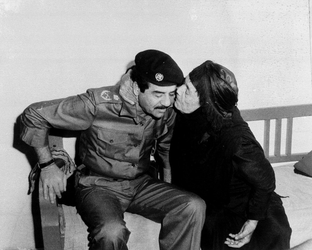 Iraqi President Saddam Hussein receives a kiss from the mother of an Iraqi soldier killed at the front during the war with Iran, in this Nov. 10, 1980 photo. (AP Photo) Ref #: PA.8645692  Date: 10/11/1980