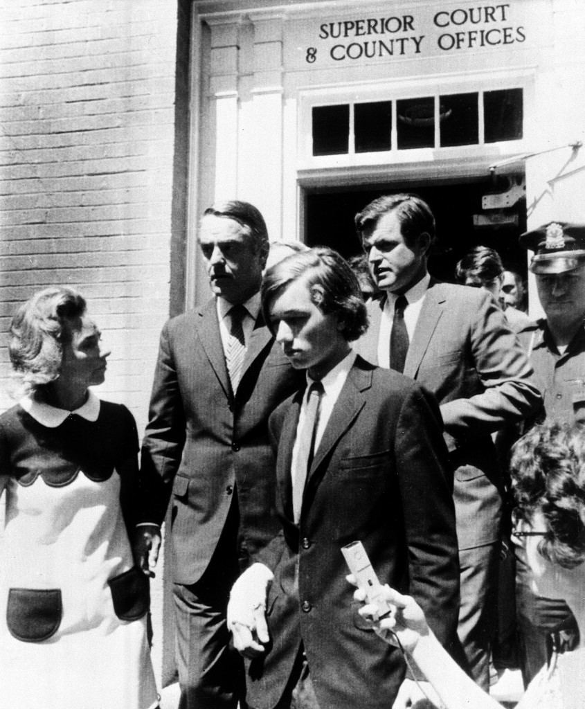 Robert Kennedy Jr., 16-year-old son of the late Robert Kennedy, leaves court at Barnstable, Mass., after a hearing on charges of possession of marijuana, Aug. 6, 1970. Accompanying him are his mother, Ethel, left, uncles Sargent Shriver, upper left, and Sen. Edward Kennedy. The young Kennedy has a wrist bandage from a fall. (AP Photo) Ref #: PA.8646646