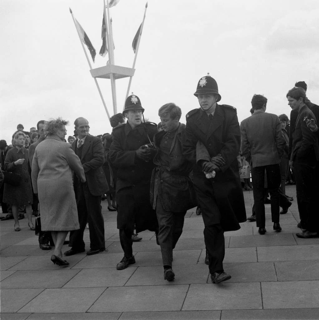 Police arrest a youth in Brighton, Sussex, April 19, 1965, during disturbances when thousands of Mods and Rockers invaded the resort. Police were on duty in large numbers to deal with hooliganism. (AP Photo/Str) Ref #: PA.8648554