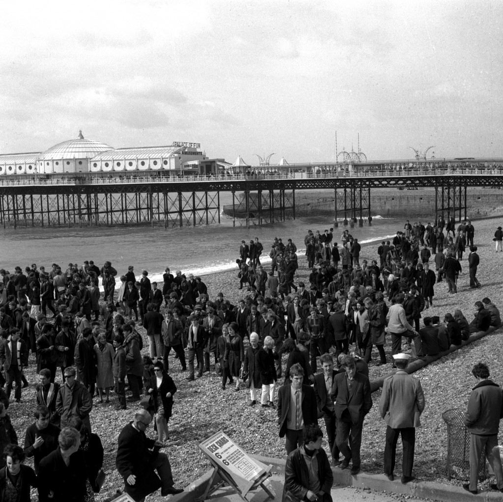 Mods and Rockers arrive on Brighton beach, Sussex, April 19, 1965, before being routed by the police. Thousands of youths from London and the surrounding areas invaded Brighton, but police were waiting for them in force and quickly moved in to prevent a repetition of last year's rioting. (AP Photo) Ref #: PA.8656450