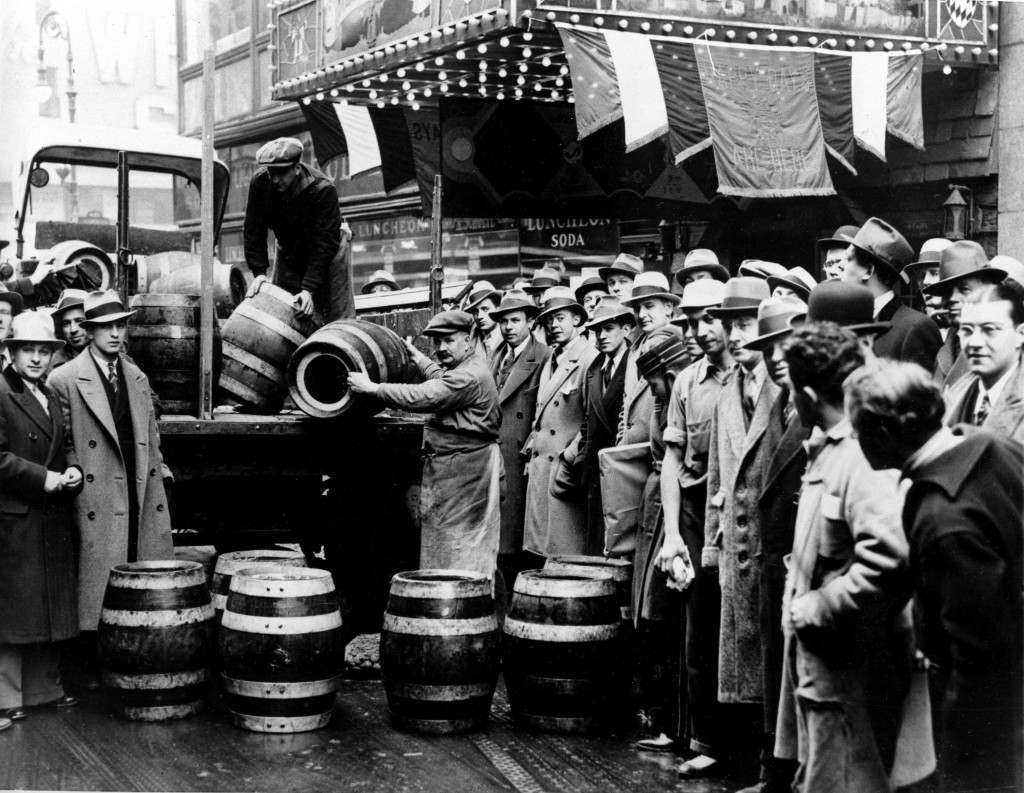 A crowd gathers as kegs of beer are unloaded in front of a restaurant on Broadway in New York City, the morning of April 7, 1933, when low-alcohol beer is legalized again. (AP Photo) Ref #: PA.8660465 Date: 07/04/1933