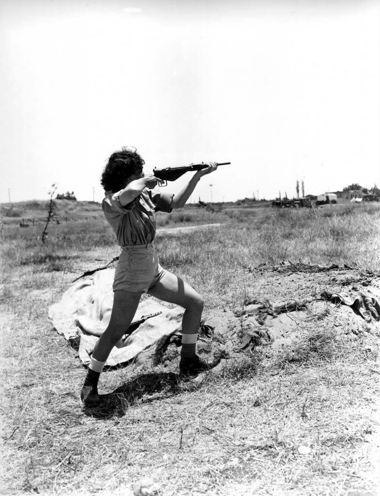 A female officer in charge of the range at the Hen women's corps camp near Tel Aviv, Palestine, gives a demonstration in the handling of a Sten gun on June 15, 1948 in the Arab-Israeli War. Although non-combatants, members the new women's Army in Israel are taught to use guns for defense. (AP Photo) Ref #: PA.8662596 Date: 15/06/1948