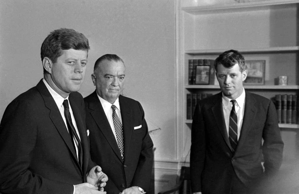 FBI Director J. Edgar Hoover has two listeners in President John F. Kennedy and his brother, Attorney General Robert Kennedy, during a White House conference, February 23, 1961. Hoover and the attorney general are official visitors. (AP Photo/Henry Burroughs) Ref #: PA.8662849  Date: 23/02/1961