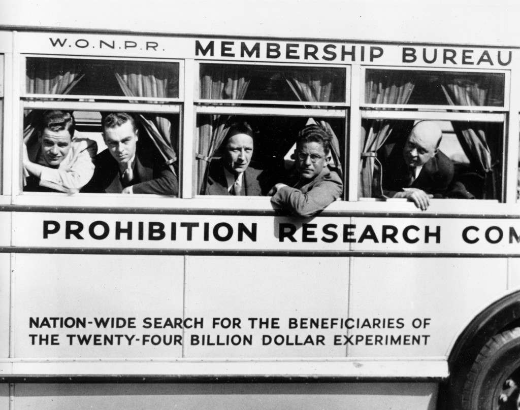 Five members of the alchohol Prohibition Research Committee depart on the bus Diogenes, named after the man who sought in vain for an honest man, in New York City, June 1, 1932. The membership is seeking one drunk who has been reformed by the 18th amendment in their campaign against the liquor ban. From left are, Stephen Duggan Jr., assistant investigator; Russell Salmon, chief investigator; Ernest Boorland Jr., member of the executive committee; Robert Nicholson, assistant director; and Paul Morris, director. (AP Photo) Ref #: PA.8663757 Date: 01/06/1932