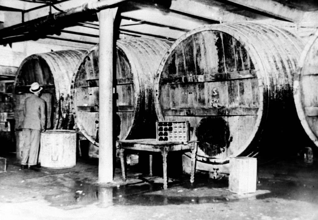 Large beer vats are seized by prohibition agents on West 25th Street in New York City, July 22, 1931. (AP Photo) Ref #: PA.8664676 Date: 22/07/1931