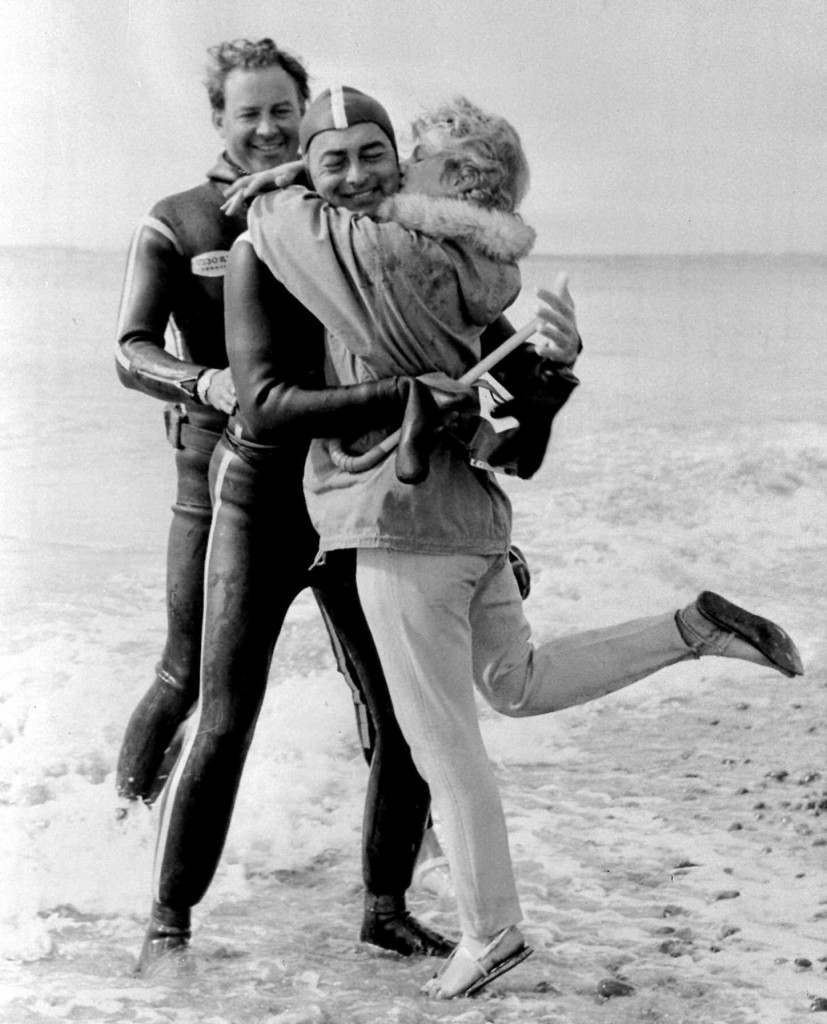Fred Baldasare, 38, a Florida film producer, gets an enthusiastic hug from his German fiance, Friederike Von Bernhard of Munich July 11,1962 at Sandwich, England. He had emerged from the water after an undewater swim of the English channel , completing the 22-mile swim from Calais, France, in 13 hours and one minute. He swam in a boat-towed cage, 15-foot below the surface, wearing a frogman outfit and breathing from an oxgen bottle. (AP Photo) Ref #: PA.8665130  Date: 11/07/1962