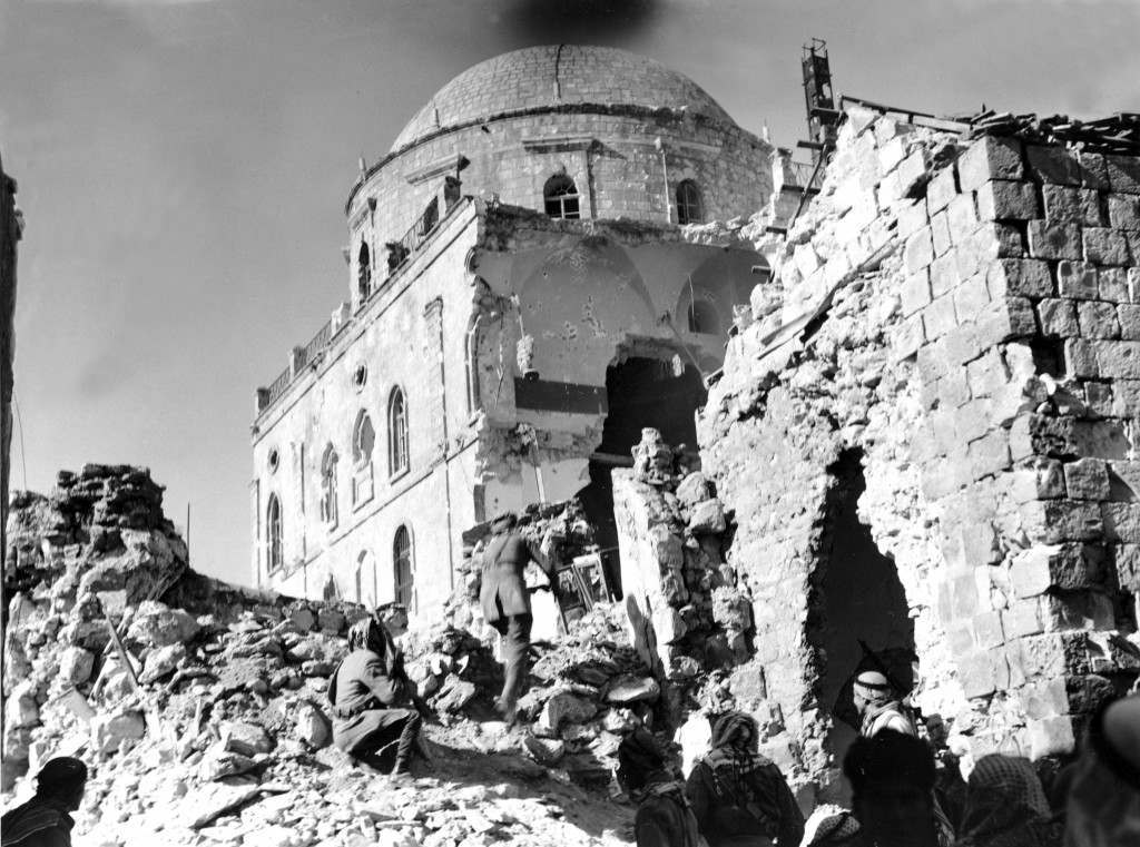 Arab soldiers approach a huge breach in the walls of Tiferet Synagogue, a stronghold of the Haganah in the Old City of Jerusalem, on May 21, 1948 during the Arab-Israeli War. Arab demolition squads blasted holes in the structure which was being used as a fortress by Haganah forces, an underground Zionist military organization. (AP Photo) Ref #: PA.8665222 Date: 21/05/1948