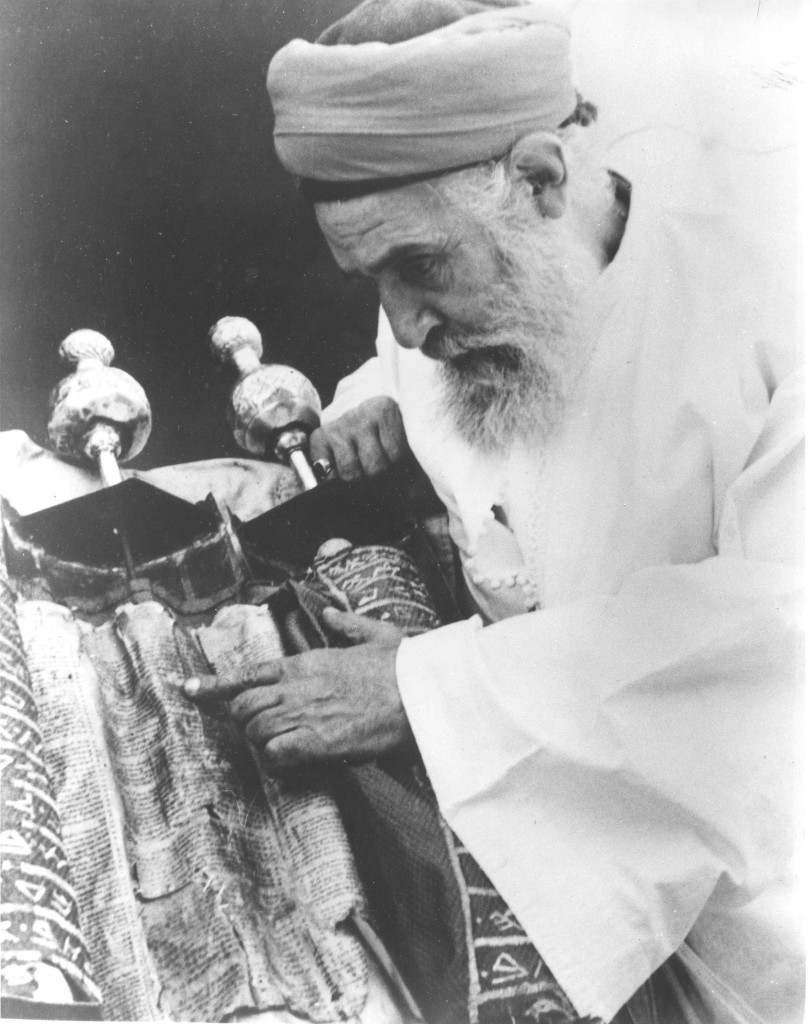 A Samaritan Jew patriarch points to the words of the Torah, or Law of Moses, on the scroll in Nablus, Jordan, circa 1952. (AP Photo/Harry Koundakjian) Ref #: PA.8666761  Date: 12/11/2002