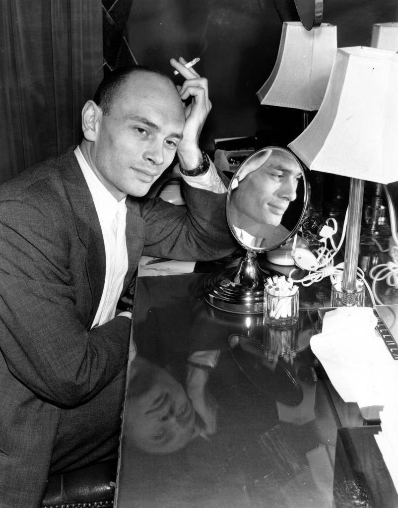 Yul Brynner poses in his dressing room at the St. James Theater in New York City on April 6, 1951. Brynner is playing the role of King Mongkut in the Broadway production of Rodgers and Hammerstein's musical Ref #: PA.8667892