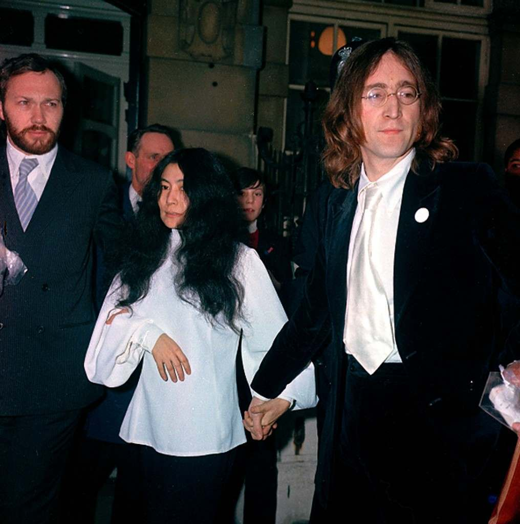 Beatle John Lennon, right, and companion Yoko Ono are arrested for possesion of marijuana after their flat was raided in London, England, on Oct. 18, 1968. (AP Photo/Boyton) Ref #: PA.8668074