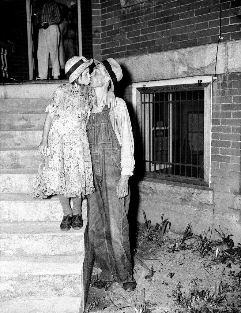 Thirty-two-year-old mountaineer Homer Peel kisses his bride Geneva on the courthouse steps at Madisonville, Tenn., June 25, 1937, after he was told by the court that he could keep his 12-year-old wife. Peel testified he married the child after his efforts to get her into an orphanage proved unavailing. (AP Photo) Ref #: PA.8669053  Date: 25/06/1937