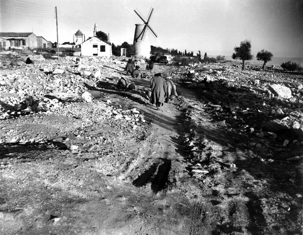 Jews crawl and run to dodge Arab snipers as they return to their homes in the village of Montefiore on the outskirt of Jerusalem after their day's work on Jan. 20, 1948. Palestinian Arabs fired from the walls of the old part of Jerusalem during conflict between Arabs and Jews during partition. (AP Photo) Ref #: PA.8673255 Date: 20/01/1948