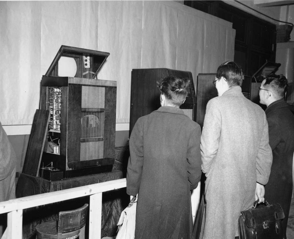 Visitors to the television demonstration at the studios of the Japanese Broadcasting Company wait for the show to appear on the screen of one on the receivers, in Tokyo, March 27, 1949. These receiving sets, which will have screens measuring eight by ten inches, are not ready for the market yet. (AP Photo/Charles P. Gorry) Ref #: PA.8679577