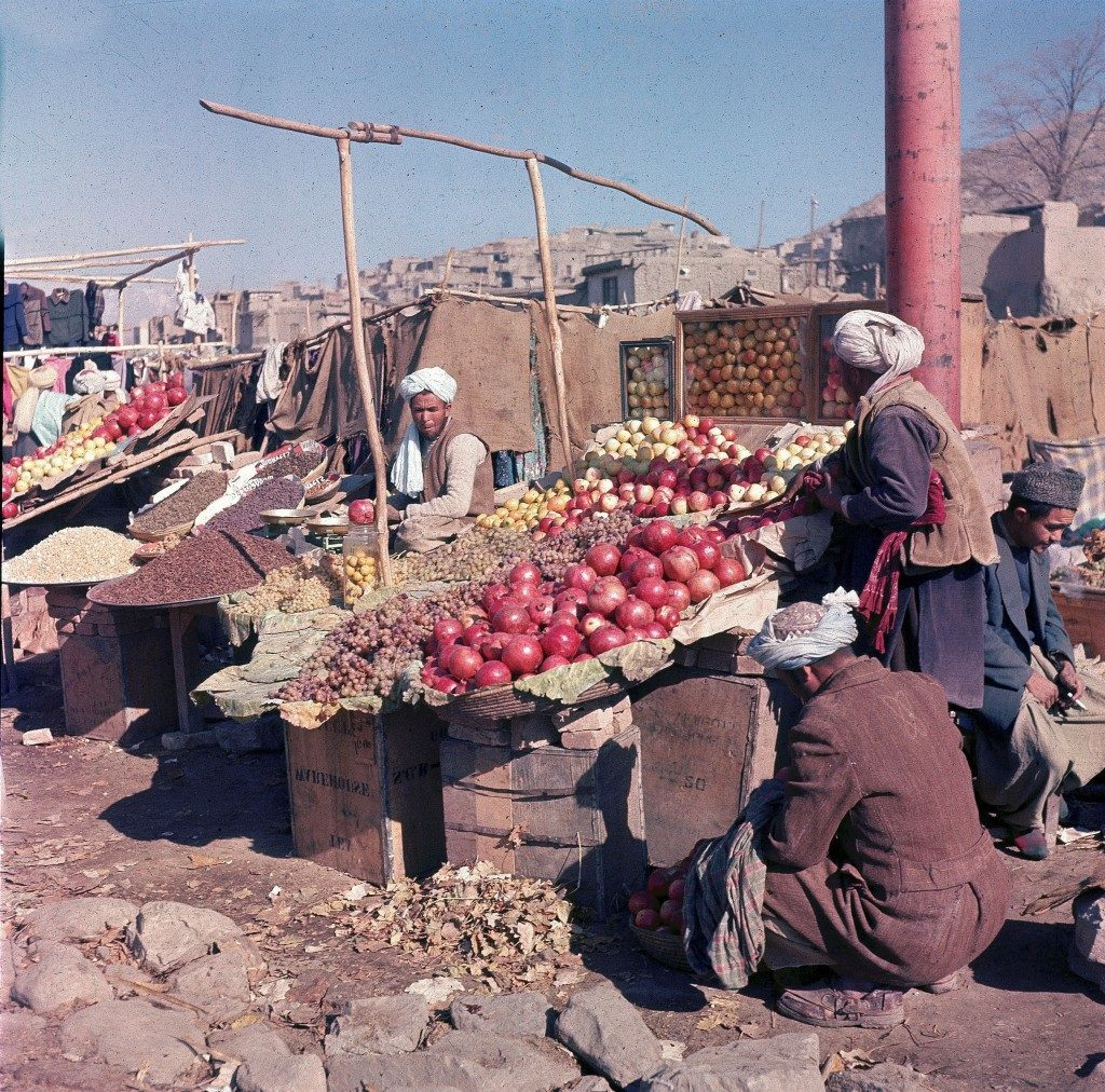 Vendors selling various fuits and nuts are shown at an outdoor market in Kabul, Afghanistan, Nov. 1961. (AP Photo/Henry S. Bradsher)