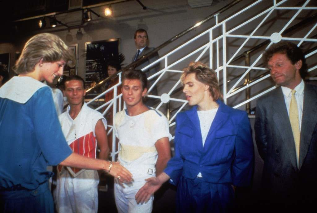 Britain's Princess Diana shakes hands with Nick Rhodes, the keyboard player in her favorite band, British pop group Duran Duran, at a music gala concert in aid of the Prince of Wales Trust Fund in London, England, July 20, 1983. (AP Photo/Bob Dear) PA-8682382