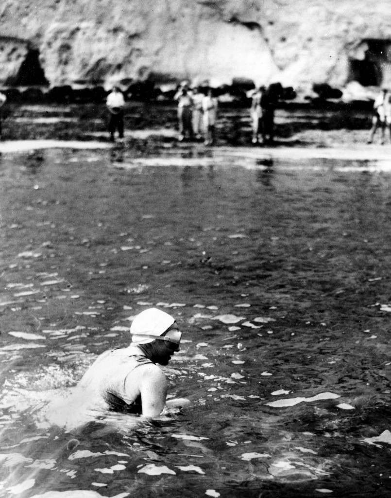Florence Chadwick scrambles through shallow water to the coast at South Foreland Beach near Dover, England, on Aug. 8, 1950, at the end of her record-breaking swim across the English Channel from France. The 31-year-old swimmer reached the English coast in 13 hours and 28 minutes from Cap Gris Nez, France, breaking the women's record of 14 hours and 34 minutes set in 1926. (AP Photo) Ref #: PA.8682574  Date: 08/08/1950